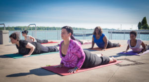 Diverse Yoga class featuring bigger bodies and women of color